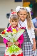 Portrait of two girls in school September 1 - the first-grader and her younge Stock Photos