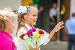 First-grader at the school the first of September in greeting waving his girl Stock Photos