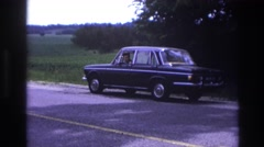 1967: woman stranded on the side of the highway in her car. FRANCE Stock Footage