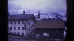 1967: a small rustic town set against a snowy mountain background FRANCE Stock Footage