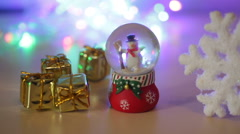 Toy snowman and a large snowflake for Christmas background Stock Footage
