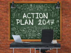 Action Plan 2017 on Chalkboard with Doodle Icons. 3D Piirros