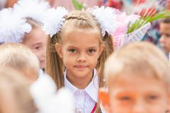 First grader close-up in a crowd of children on line the first of September Stock Photos
