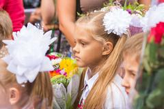 First grader standing in a crowd of children on line the first of September Stock Photos