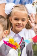 First grader on the first of September, the line greeting waving friend Stock Photos