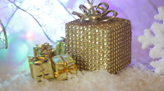 Golden Christmas gift border with decorative luxury gifts over a textured gold Stock Footage