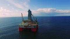 Aerial view of oil producing platform deep ocean Stock Footage