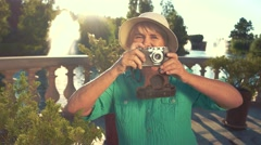 Senior woman with photo camera. Stock Footage