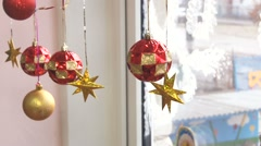 Christmas balls, stars hanging in the window Stock Footage