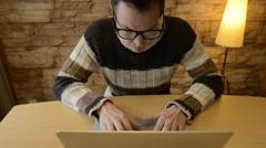 Man using laptop computer getting upset Stock Footage