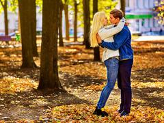 Young couple hugging and flirting in park. Autumn love. Kuvituskuvat