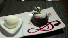 Brownie dessert with original feed from chef in a luxurious restaurant Stock Footage