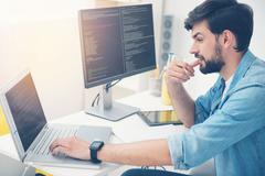 Young programmer coding in an office Stock Photos