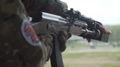Airsoft game. Check shoot the ball from the Russian AK 47 airsoft drive Stock Footage
