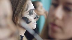 Artist drawing girl skull- makeup in art studio Stock Footage