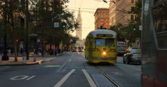 Streetcar Travels on Market Street with Ferry Building in Distance  	 Stock Footage
