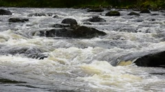 Water flowing over rocks in river in the Scottish Highlands, Scotland, UK Stock Footage