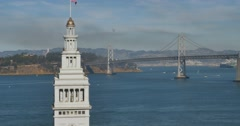 High Angle Establishing Shot Ferry Building Clocktower and Bay Bridge  Stock Footage