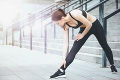 Athletic girl stretching before training Kuvituskuvat