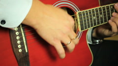 Guitarist playing on six-string acoustic guitar Stock Footage