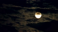 Full moon moving night sky cloudscape 4k nature video: golden moon behind clouds Stock Footage