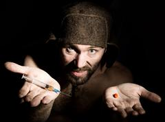 Dark portrait of scary evil sinister bearded man with smirk, offers a variety of Stock Photos