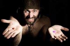Dark portrait of scary evil sinister bearded man with smirk, offers a choice of Stock Photos