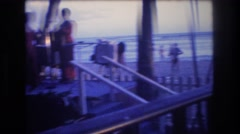 1977: beach goers enjoying the sunset HONOLULU HAWAII Stock Footage