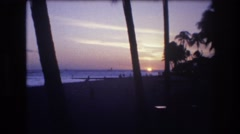 1977: beach scene water party people walking enjoy HONOLULU HAWAII Stock Footage