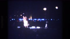 1977: plump hawaiian luau dancer doing the hula dance at night  Stock Footage