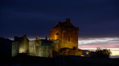 Eilean Donan Castle at night in Loch Duich, Scottish Highlands, Scotland Stock Footage