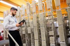 Technician using digital cable analyzer Stock Photos