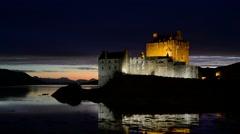 Eilean Donan Castle at night in Loch Duich, Scottish Highlands, Scotland Stock Footage