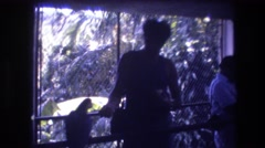 1977: women standing watching birds sitting flying trees outside unique sight Stock Footage