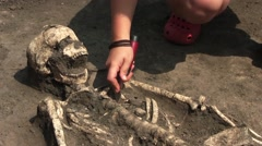 An Archeologist Is Excavating A Skeleton Of A Woman Stock Footage