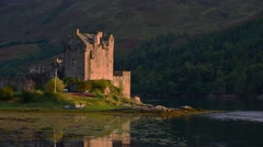 Eilean Donan Castle at sunset in Loch Duich, Scottish Highlands, Scotland Stock Footage