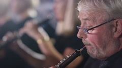 4K Symphony orchestra during a performance with focus on woodwind section Stock Footage