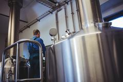 Manufacturer working at brewery Stock Photos