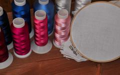 Multi-colored thread and fabric in the hoop for the embroidery and sewing Stock Photos