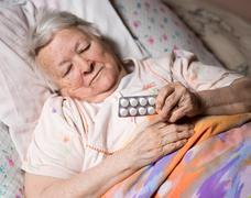 Old sick woman Stock Photos