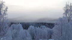 Morning mists are wafting over a frosty valley Stock Footage