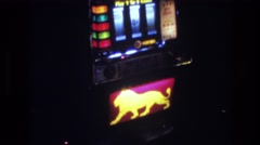 1977: golden lion design on a glowing slot machine LAS VEGAS Stock Footage
