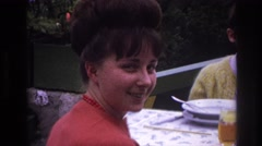 1967: a young woman smiles at the annual family reunion party. FRANCE Stock Footage