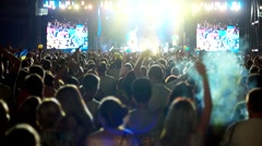 Raised hands of people on the outdoor concert, the crowd at a rock festival, a Stock Footage
