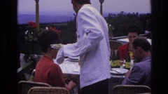 1967: waiter serving meal to woman at outdoor restaurant FRANCE Stock Footage