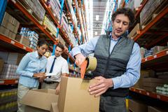 Warehouse workers preparing a shipment Stock Photos