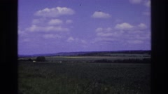 1967: beautiful green farms outer the state and no pollution and some vehicles Stock Footage