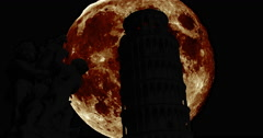 Silhouettes of the Tower of Pisa with giant moon Stock Footage