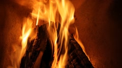 Two logs are burning in a fireplace Stock Footage