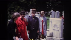1967: mourners visit a grave FRANCE Stock Footage